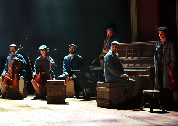 Tarek (at piano) in Swallows and Amazons. Photo by Simon Annand