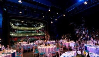Tables set for VIP Gala guests on our Theatre stage.